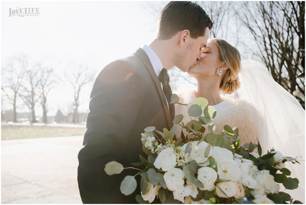 District Winery Winter Wedding bride and groom kissing portrait.JPG