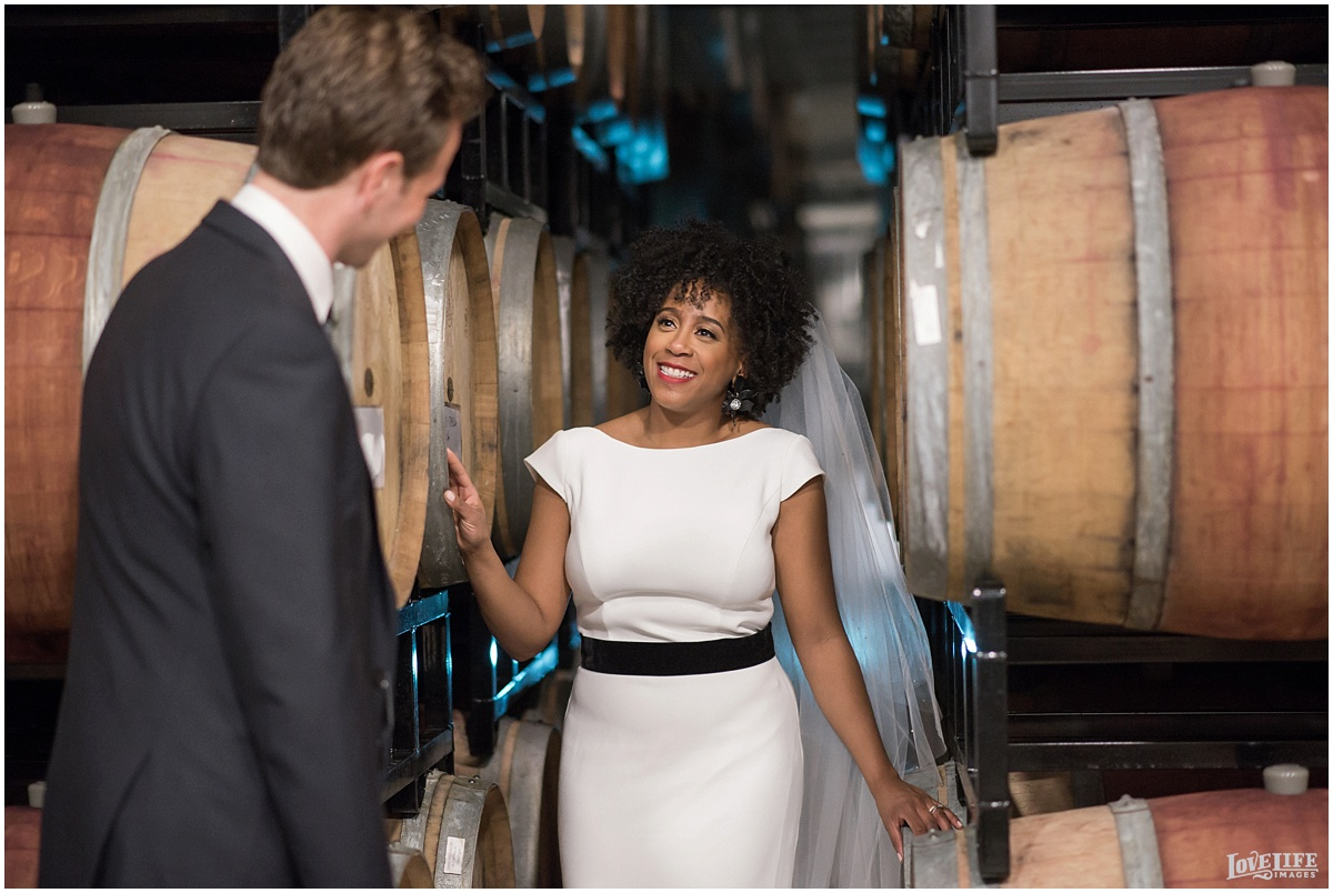 District Winery DC Wedding portrait in wine barrels.jpg