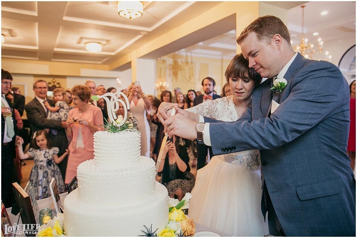Dumbarton House DC Wedding cake cutting.jpg