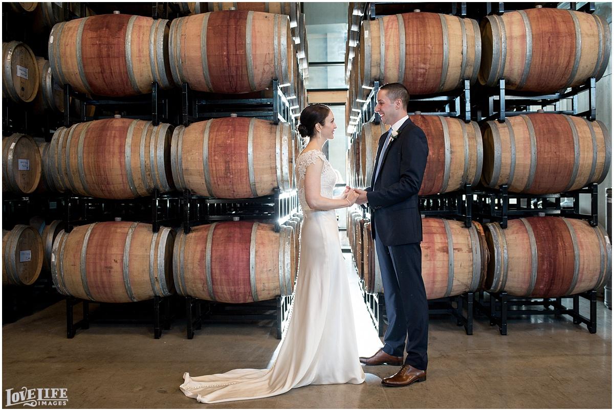 District Winery DC Wedding barrel room portrait.jpg
