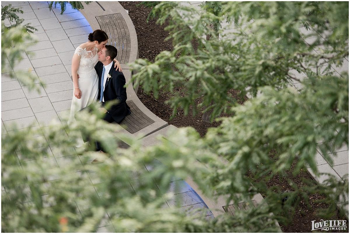District Winery DC Wedding bride kissing groom.jpg