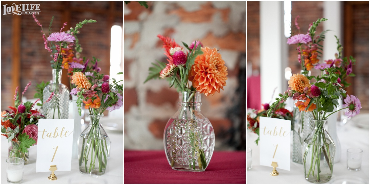 AVAM Baltimore Wedding pink and orange floral centerpieces.jpg