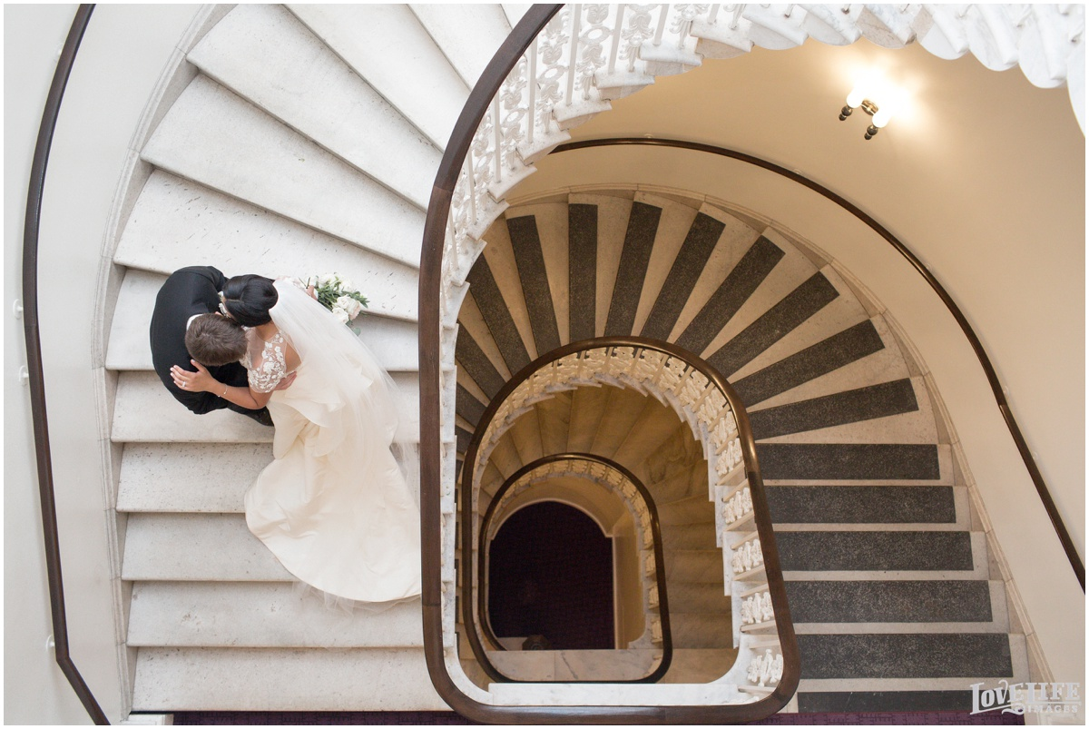 Hotel Monaco DC Wedding staircase portrait.jpg