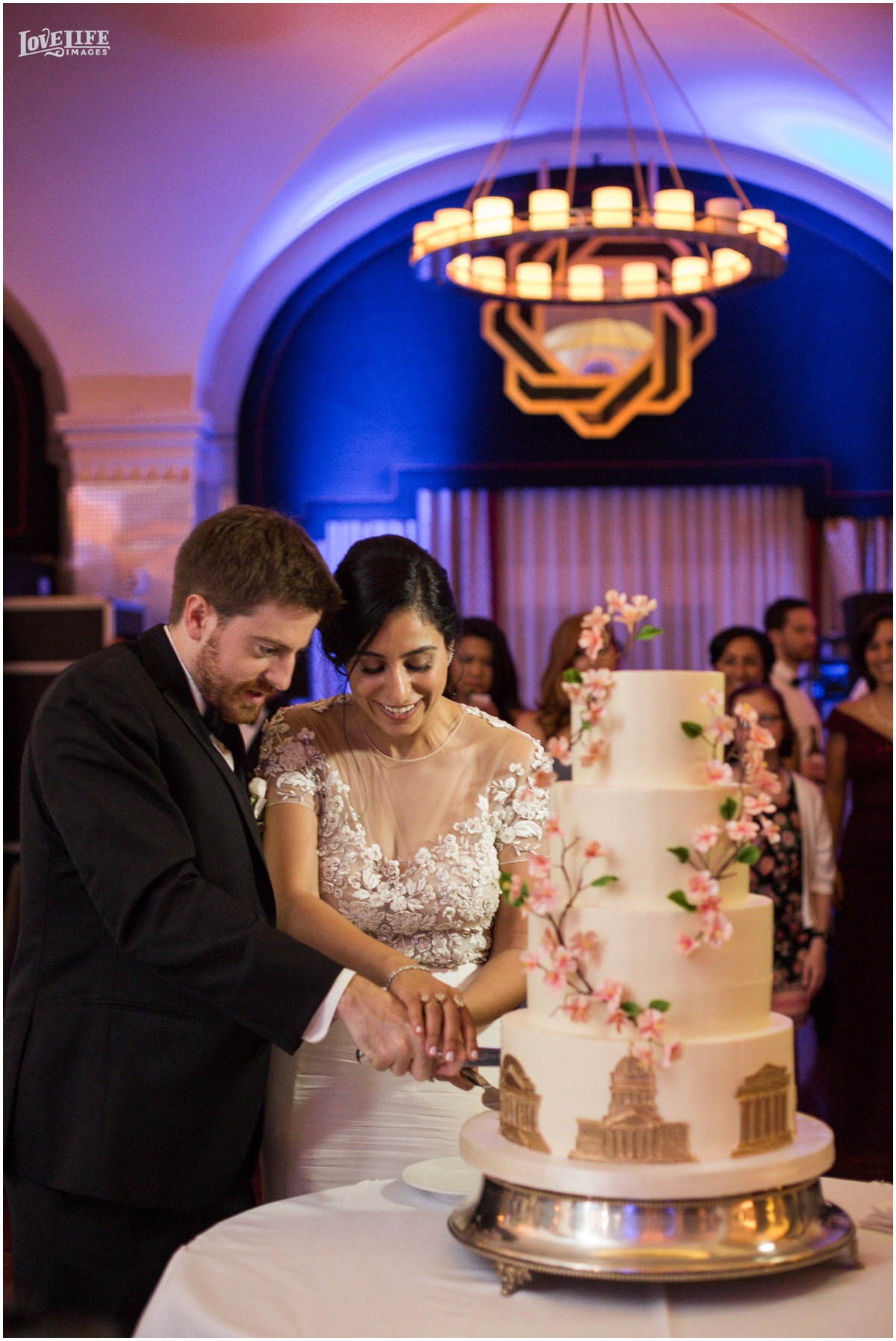 Hotel Monaco DC Wedding cake cutting.jpg