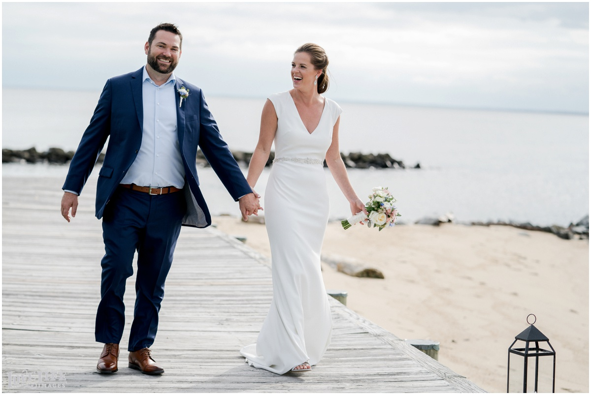 Silver Swan Bayside Wedding bride groom walking beach.jpg