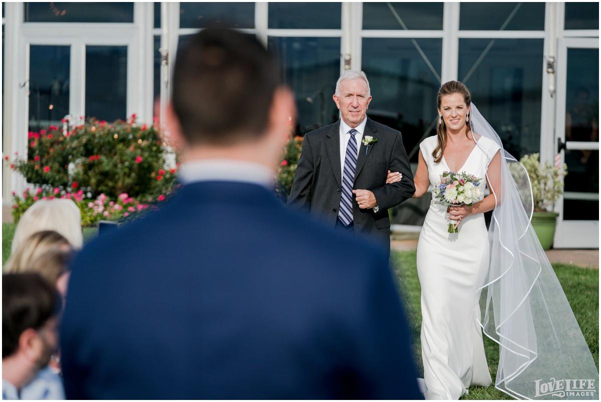 Silver Swan Bayside Wedding bride coming down aisle.jpg