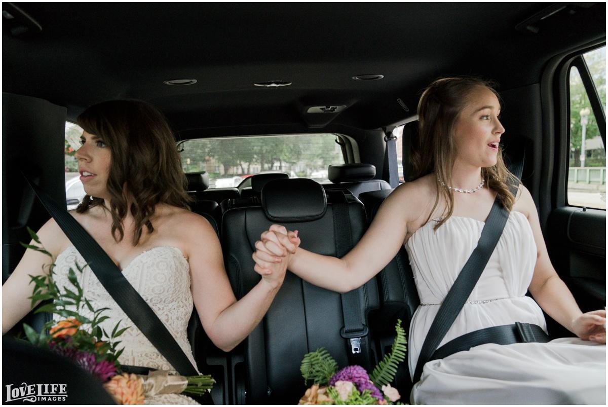 Same Sex Brewery DC Wedding brides hand holding.jpg