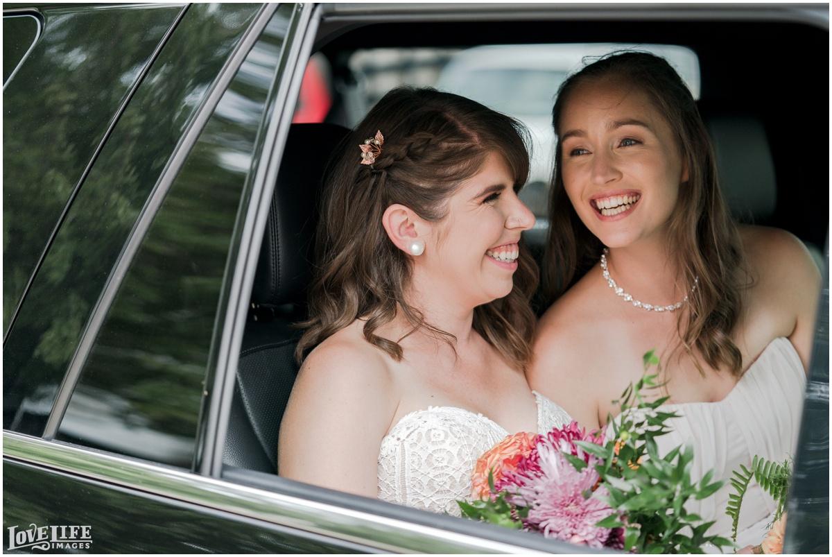 Same Sex Brewery DC Wedding brides portrait in car.jpg