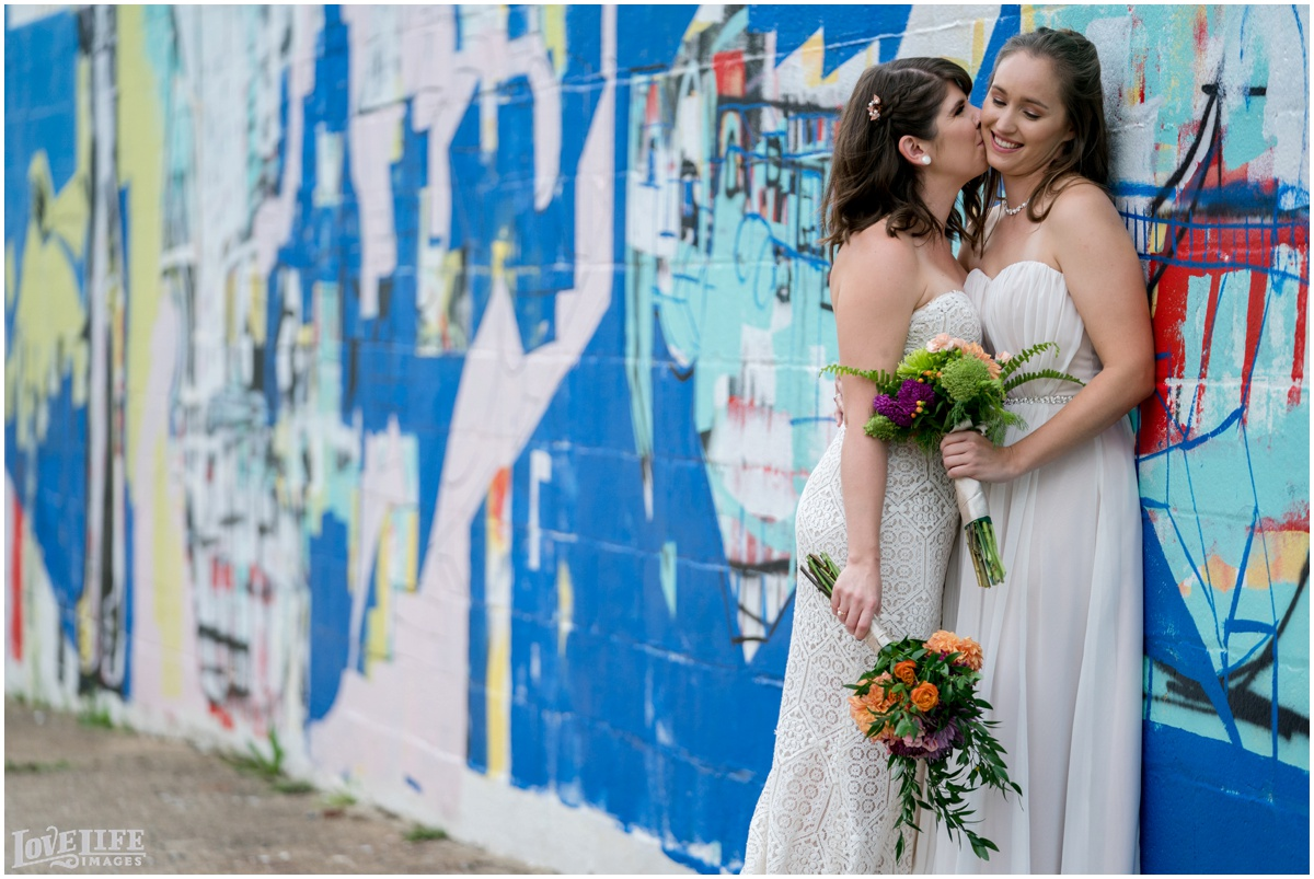 Same Sex Brewery DC Wedding brides portrait with mural.jpg