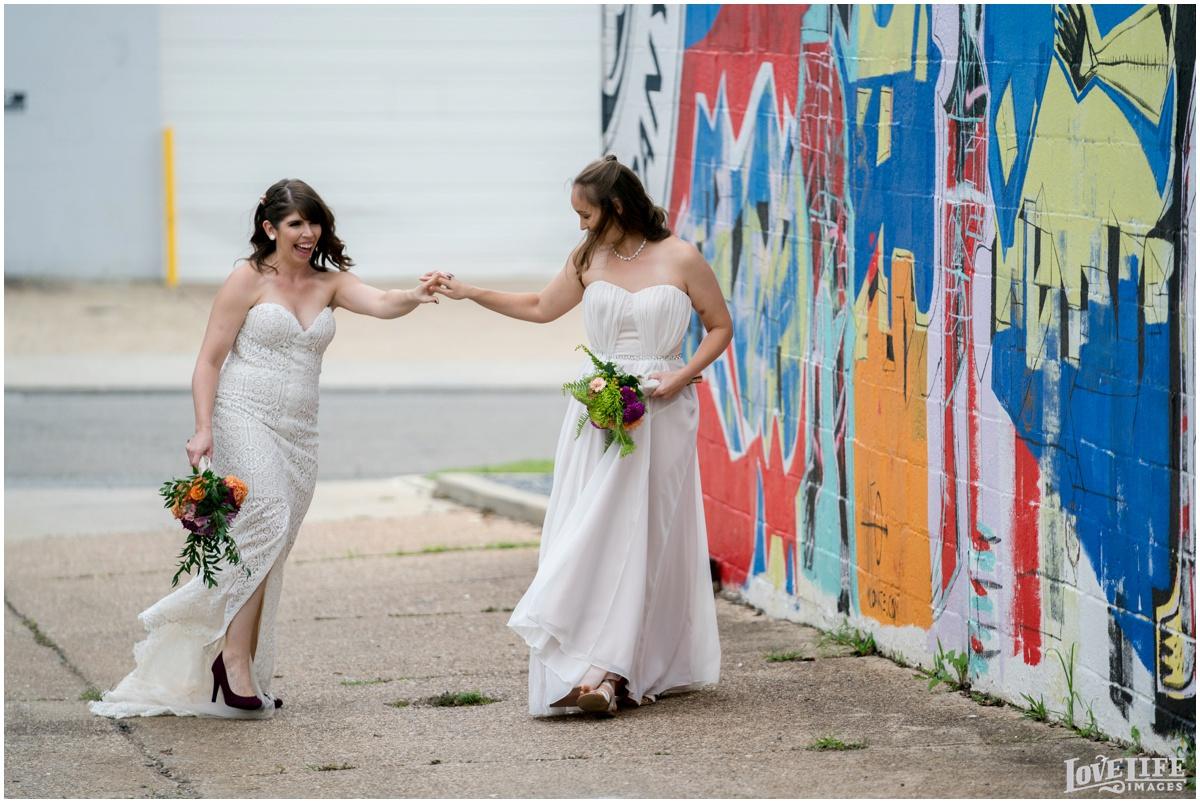 Same Sex Brewery DC Wedding brides walking portrait.jpg