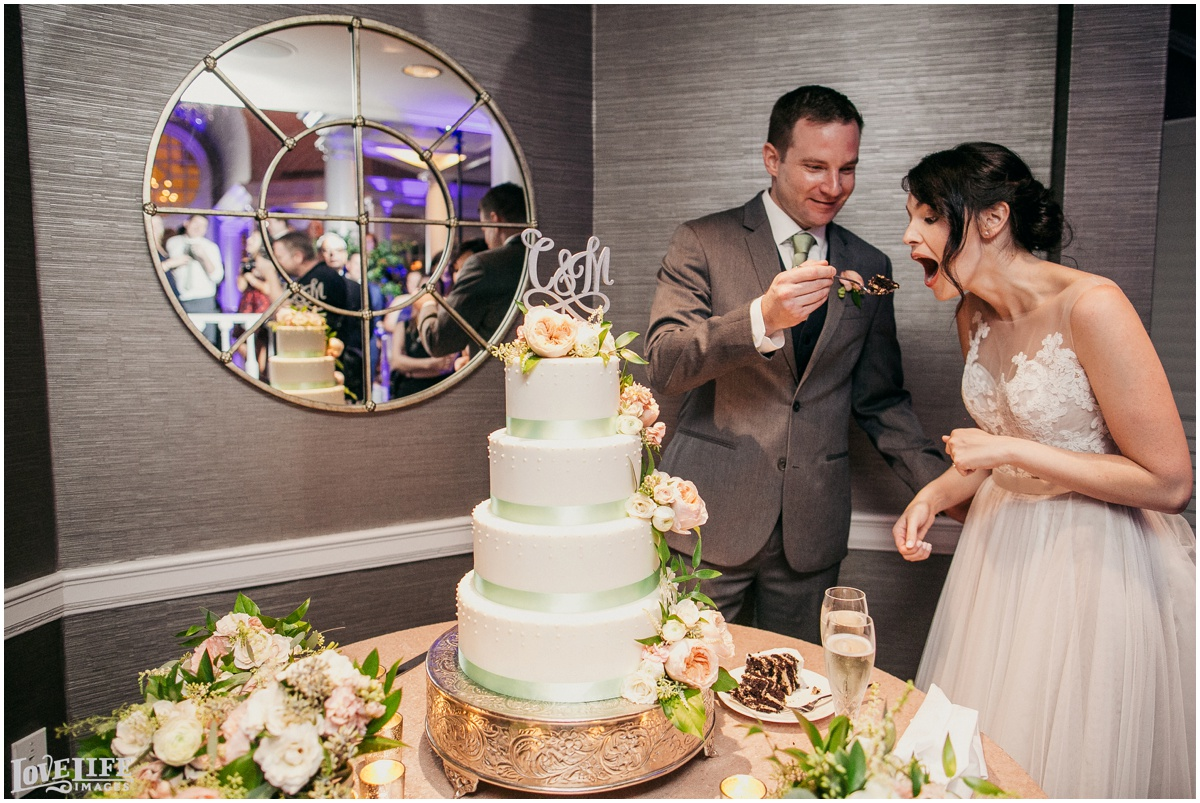 Fairmont DC Wedding cake cutting.jpg