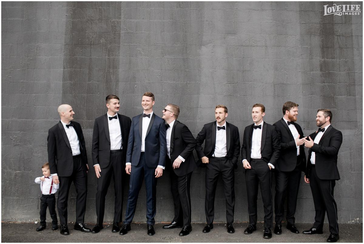 District Winery DC Wedding groomsmen portrait.jpg