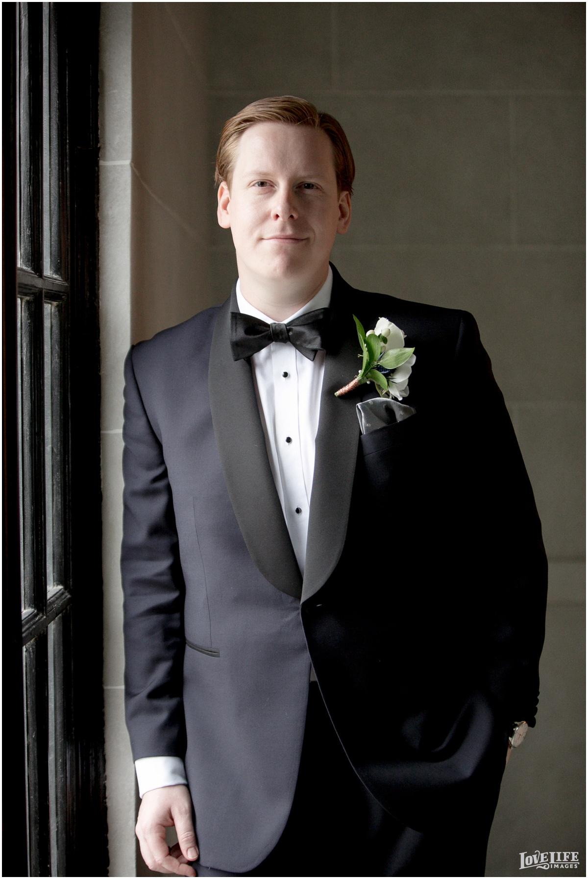 Peabody Library Baltimore Glam Wedding groom portrait.jpg