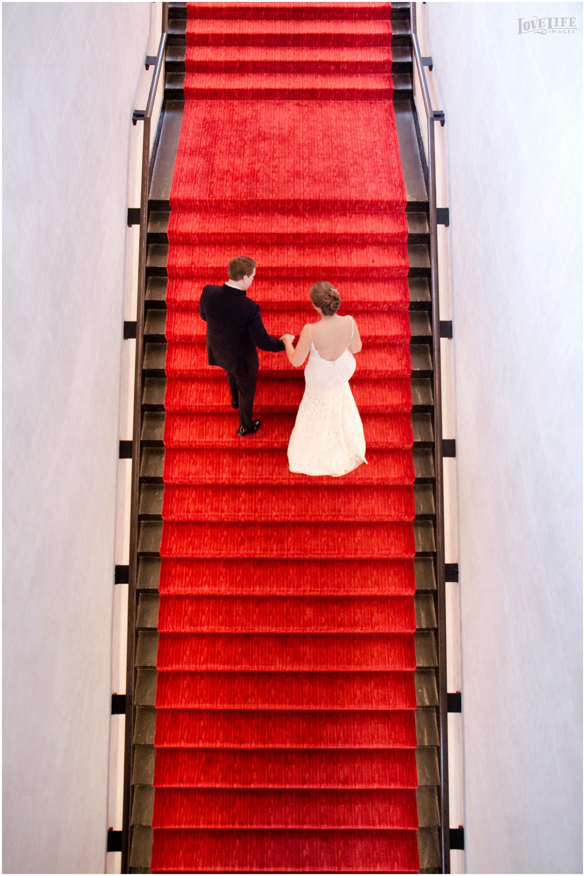 Peabody Library Baltimore Glam Wedding Sagamore Pendry staircase portrait.jpg