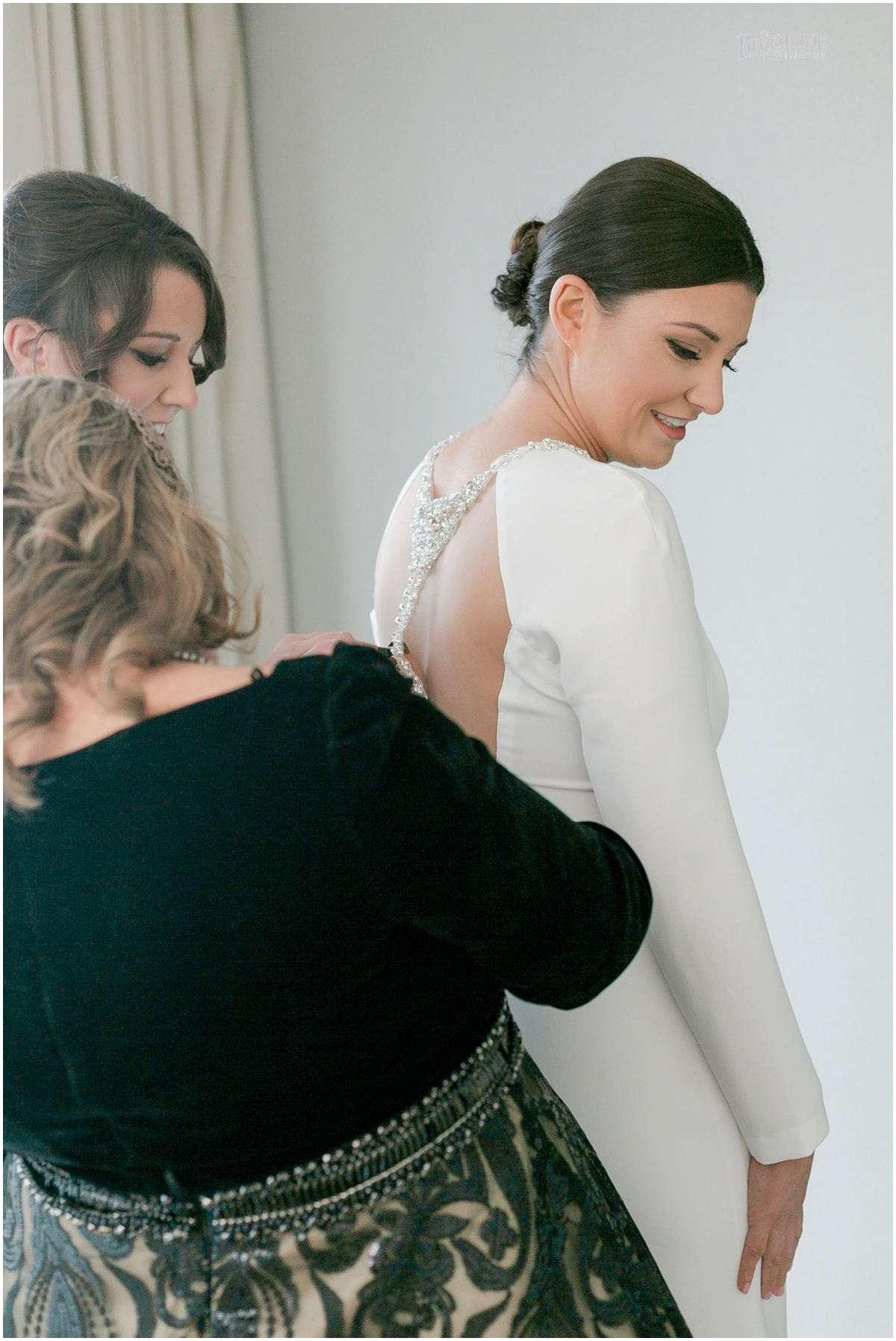 Winter District Winery Wedding bride putting on gown.JPG
