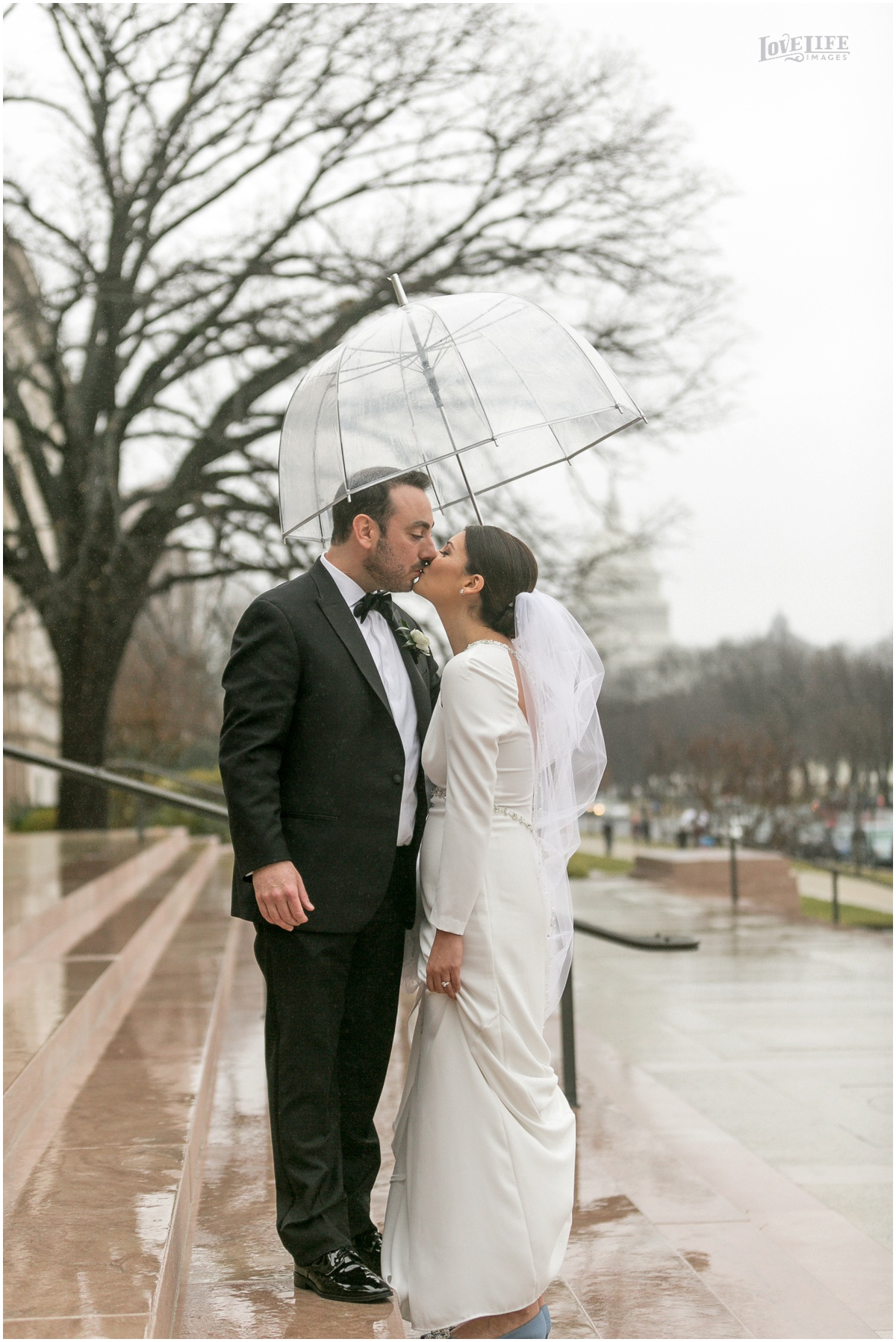 Winter District Winery Wedding bride groom kiss in rain capitol building.JPG
