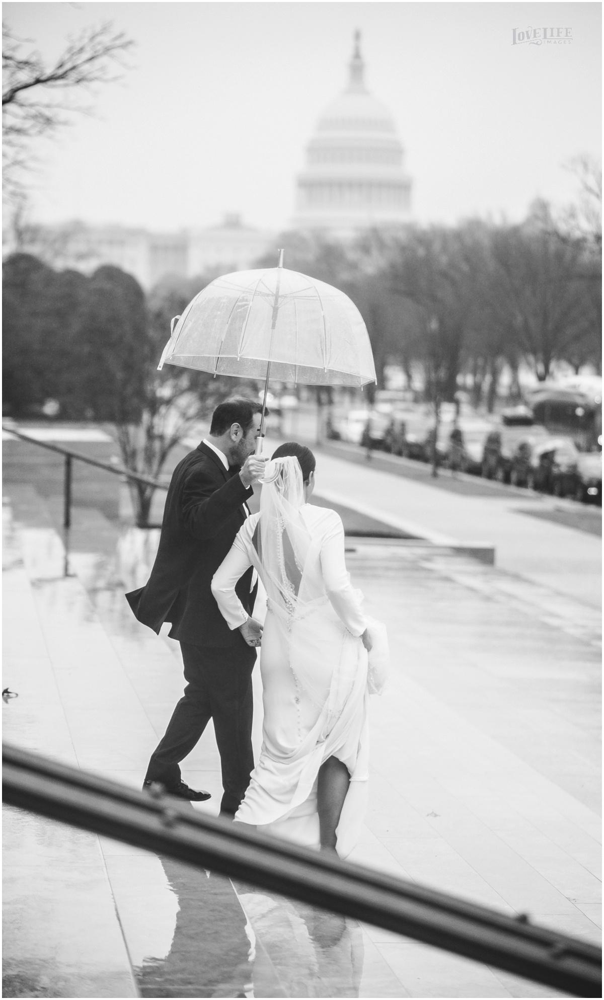 Winter District Winery Wedding bride groom in rain with capitol building.JPG