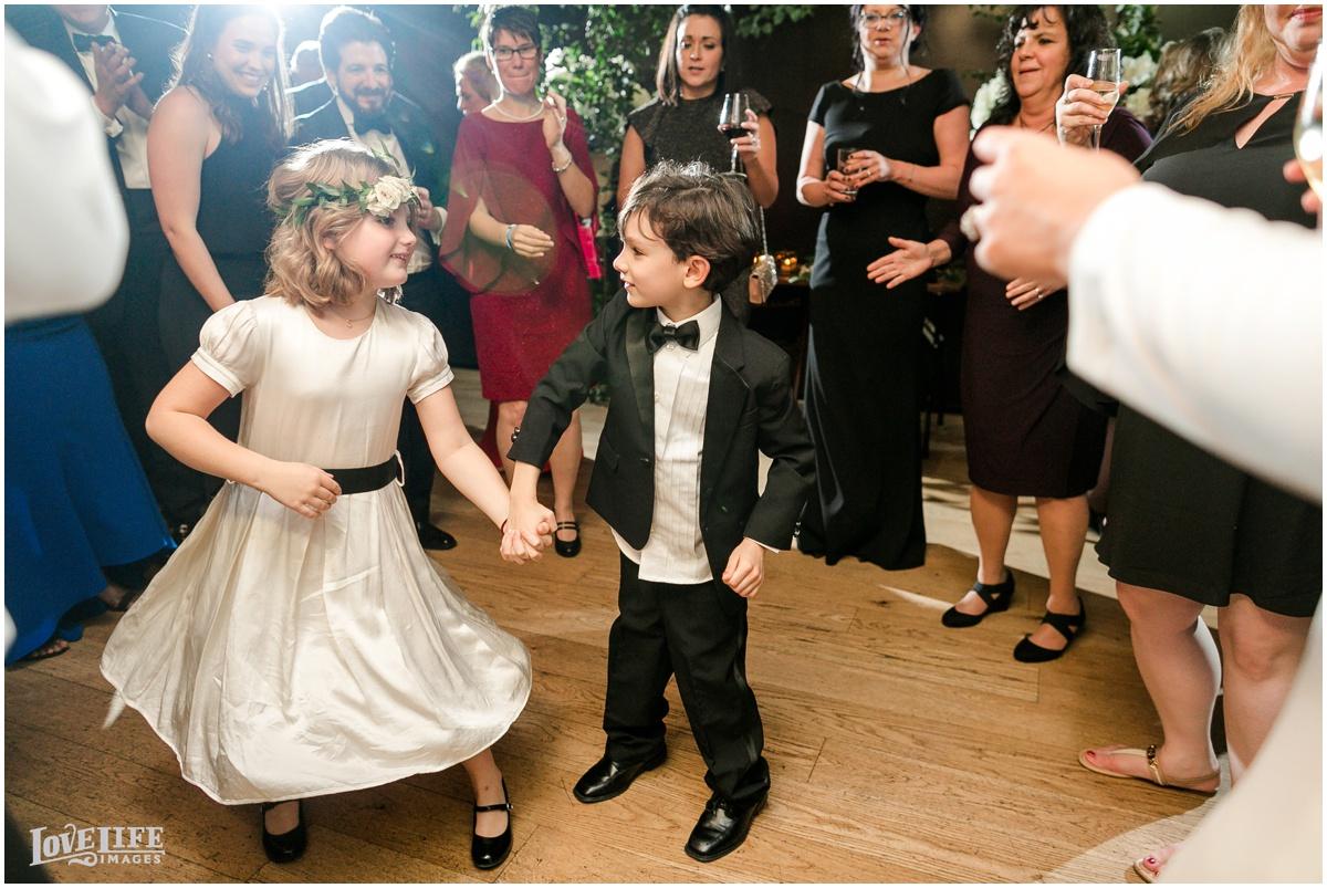 Winter District Winery Wedding ring bearer flower girl dancing.JPG