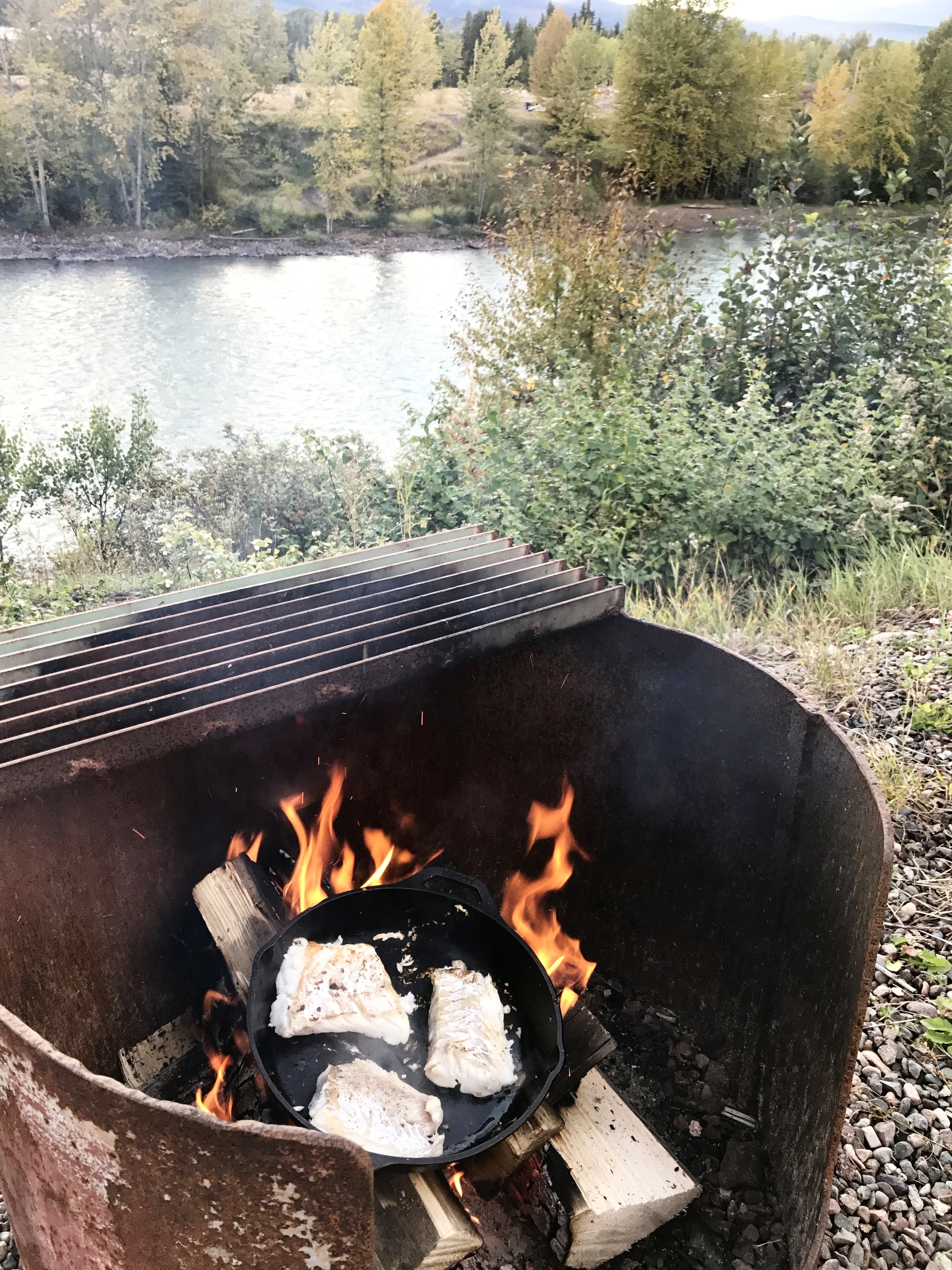 Cooking some local fish over a fire at our campsite
