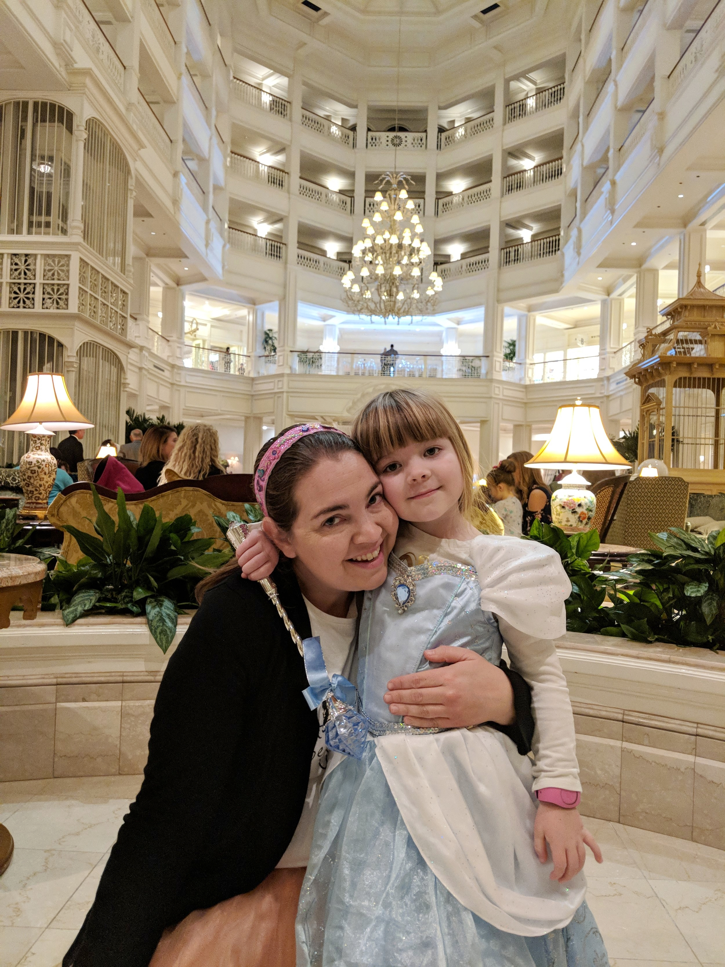 Photo of me and Annabelle in the Grand Floridian before our Princess Character Dining dinner at 1900 Park Fare.  We loved meeting Cinderella, Prince Charming, the Stepsisters and StepMother (note characters are different at this location at Breakfast and Lunch). Photo by Jon Harle (thanks love for this!)