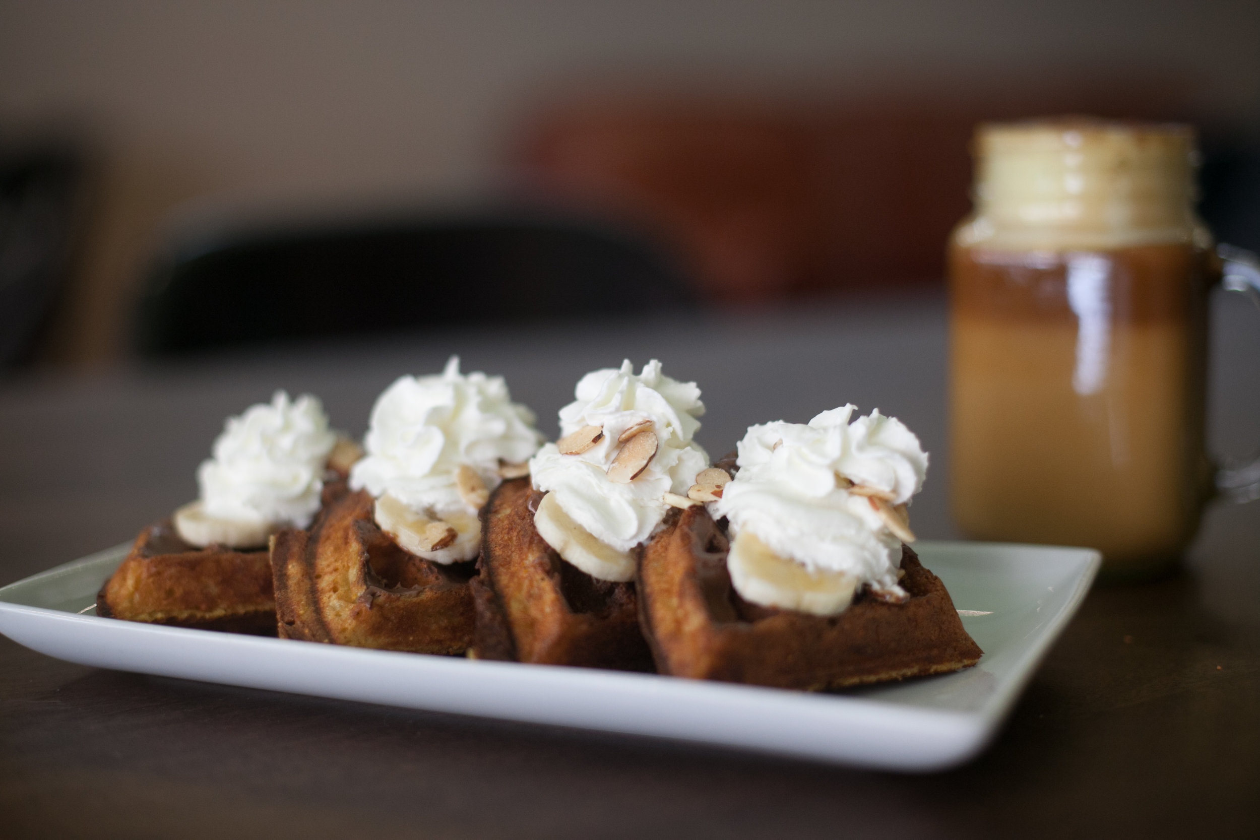 Gusto waffles (Nutella, bananas, almonds and whip cream) and Turmeric Latte Addis Cafe.  Photo by Tina Harle