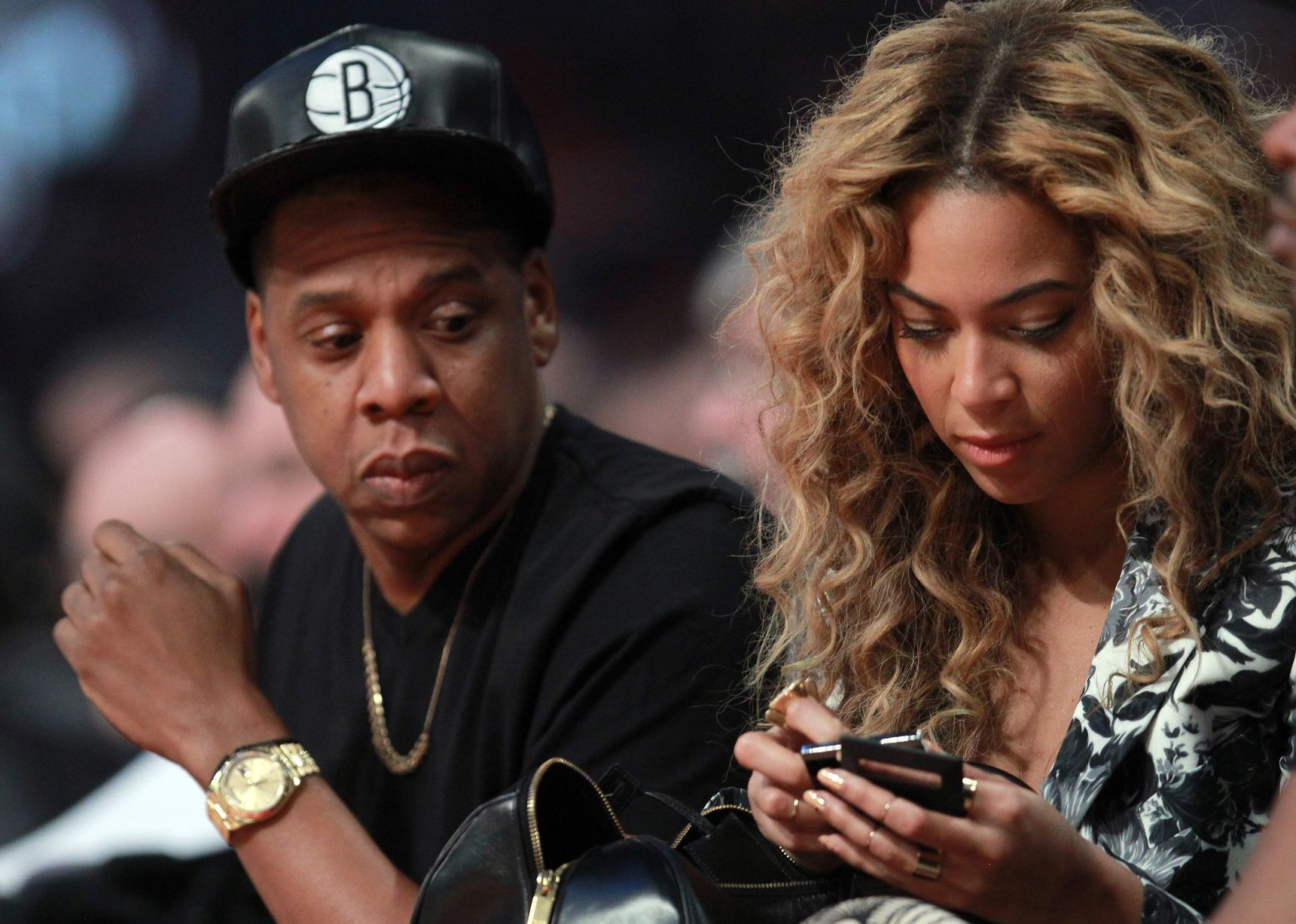 Jay-Z-looks-over-at-wife-Beyonce-during-the-2013-NBA-All-Star-game.jpg