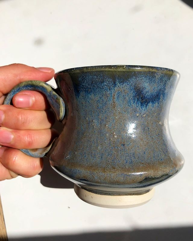 I love this shape of mug so much! It's so nice to hold around the middle, and the handle can be a smaller size with just enough space for your hands to fit in without being squished. And a nice glaze makes it even better! It's crazy how much variation can be achieved in just a cone 5 firing.