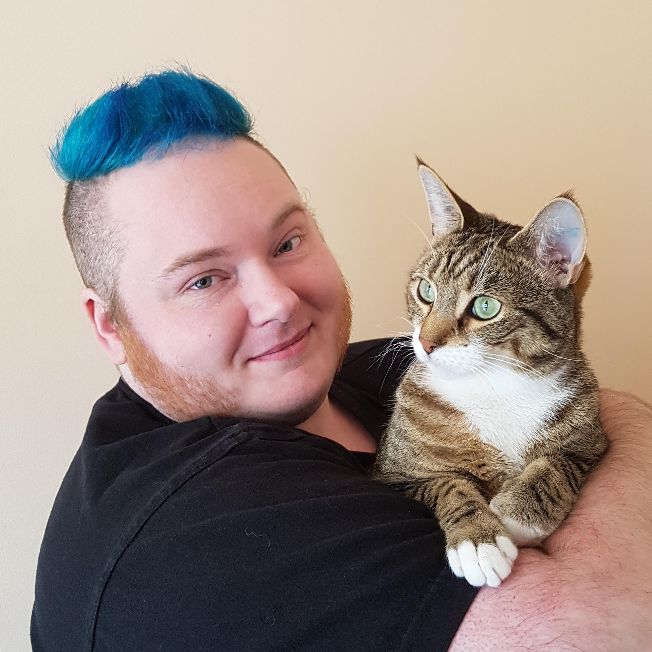 Erin Kyan, holding his cat, Boop.