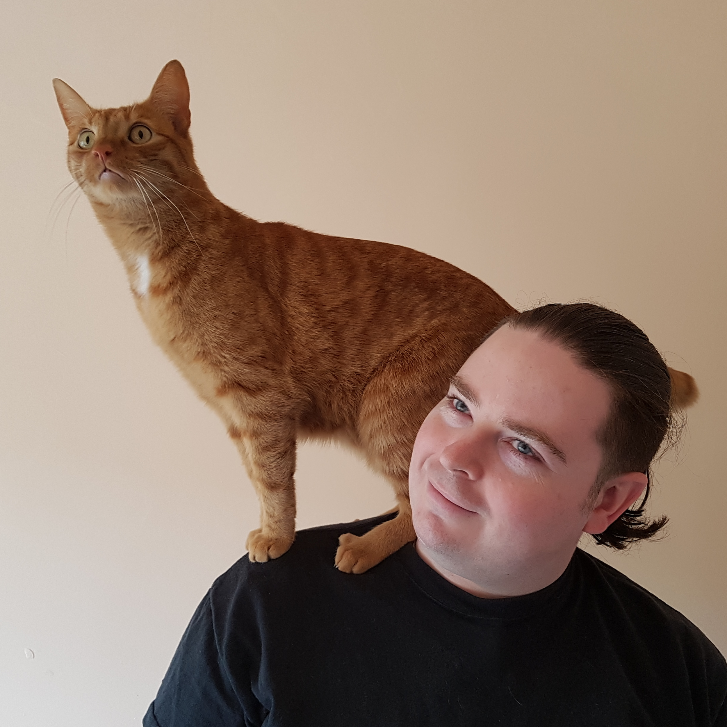 Lee Davis-Thalbourne, with his cat, Tribble, perched on his shoulders.