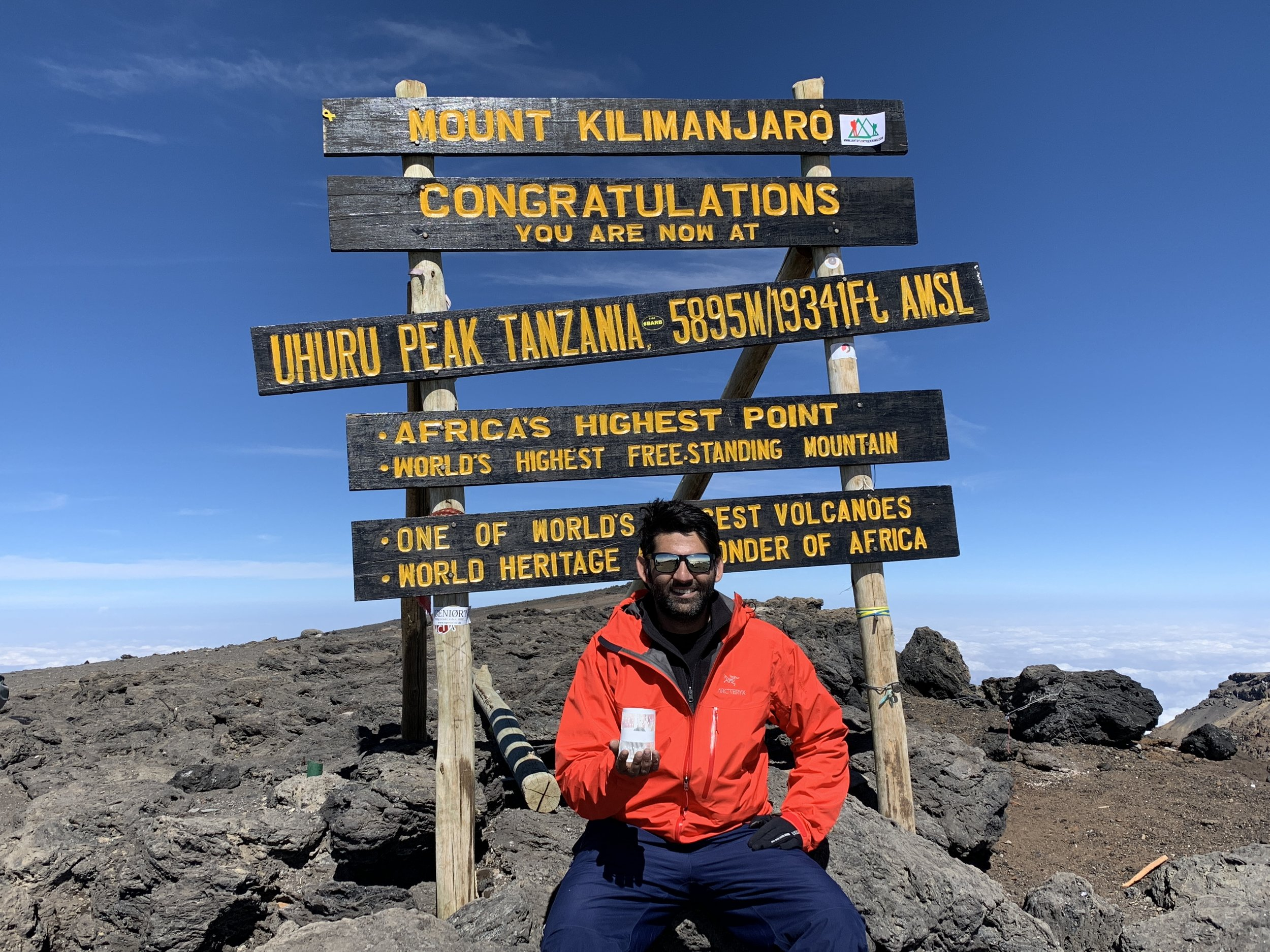 Our co-founder Sid Butalia atop Africa's highest point and mountain.
