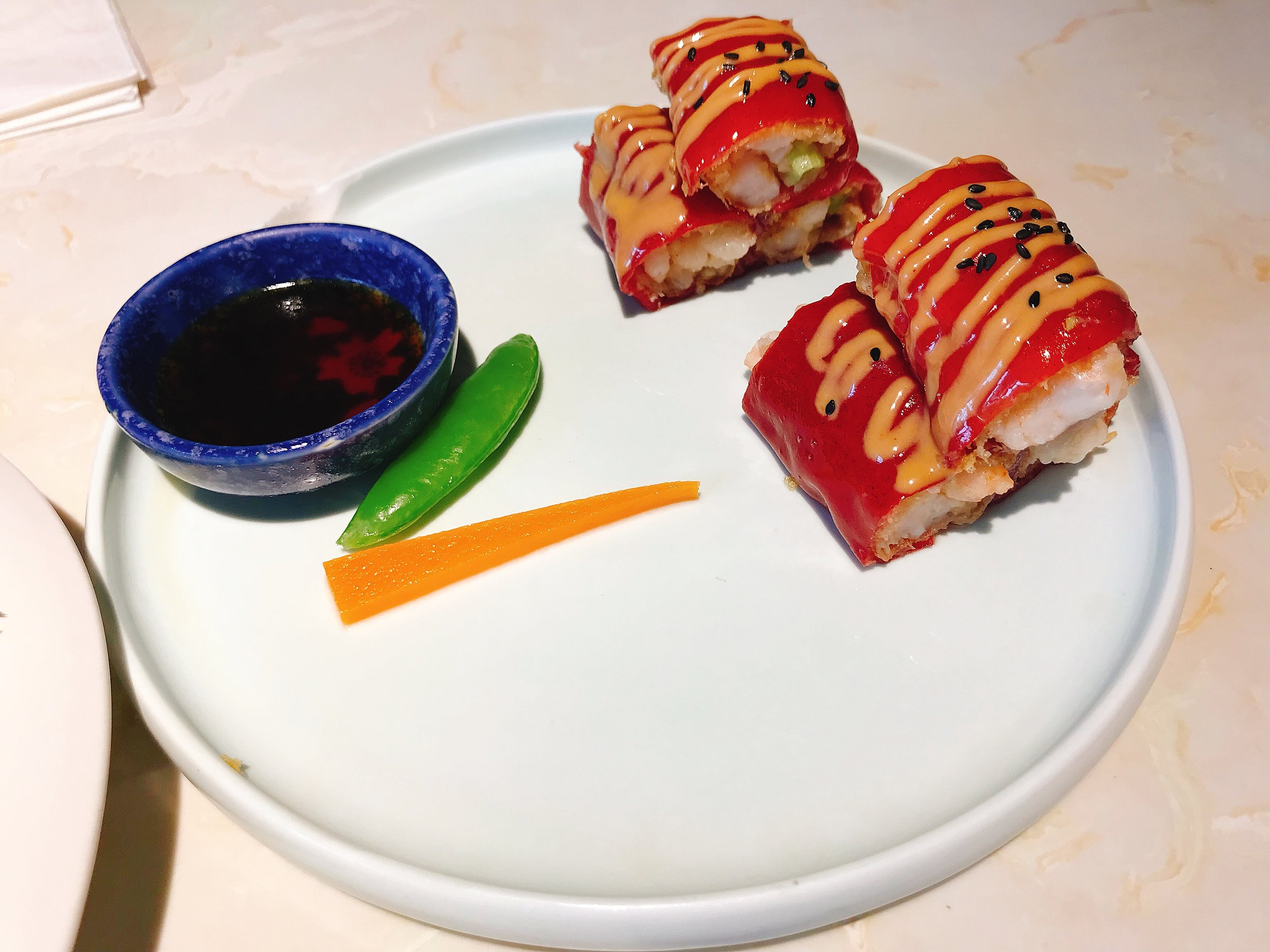 Steamed red rice roll