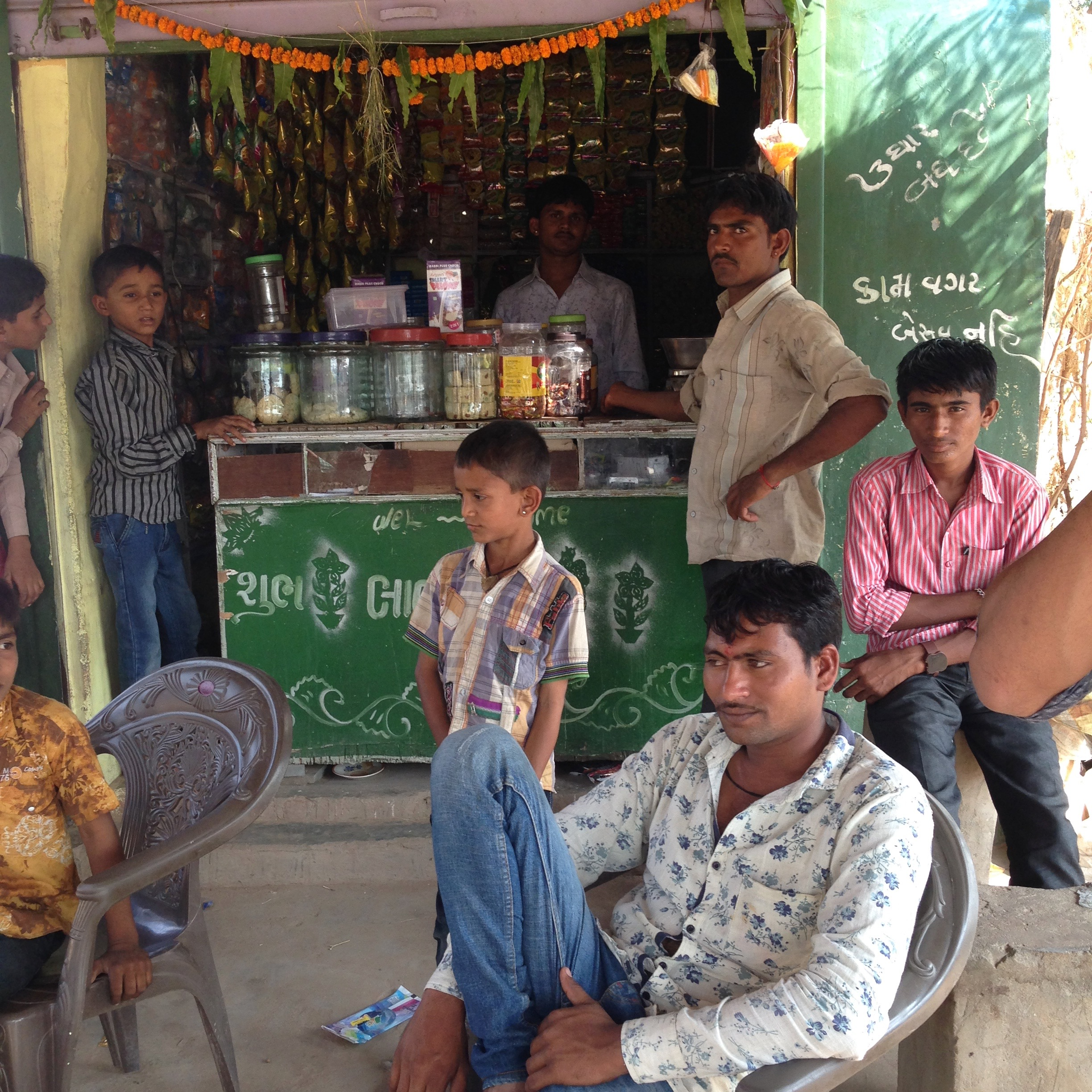 Pimps outside the village shop, Wadia, Gujarat, India