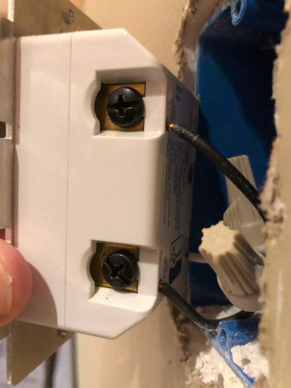 Wiring on one side of a single smart switches. Note that the black wires connect to the line and load terminals just like a basic switch that is being replaced.