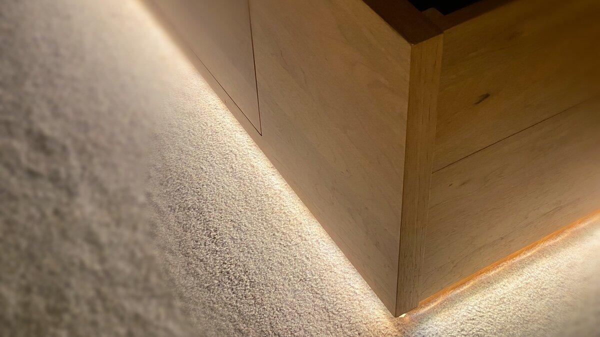 Strip installed under edge of bed base