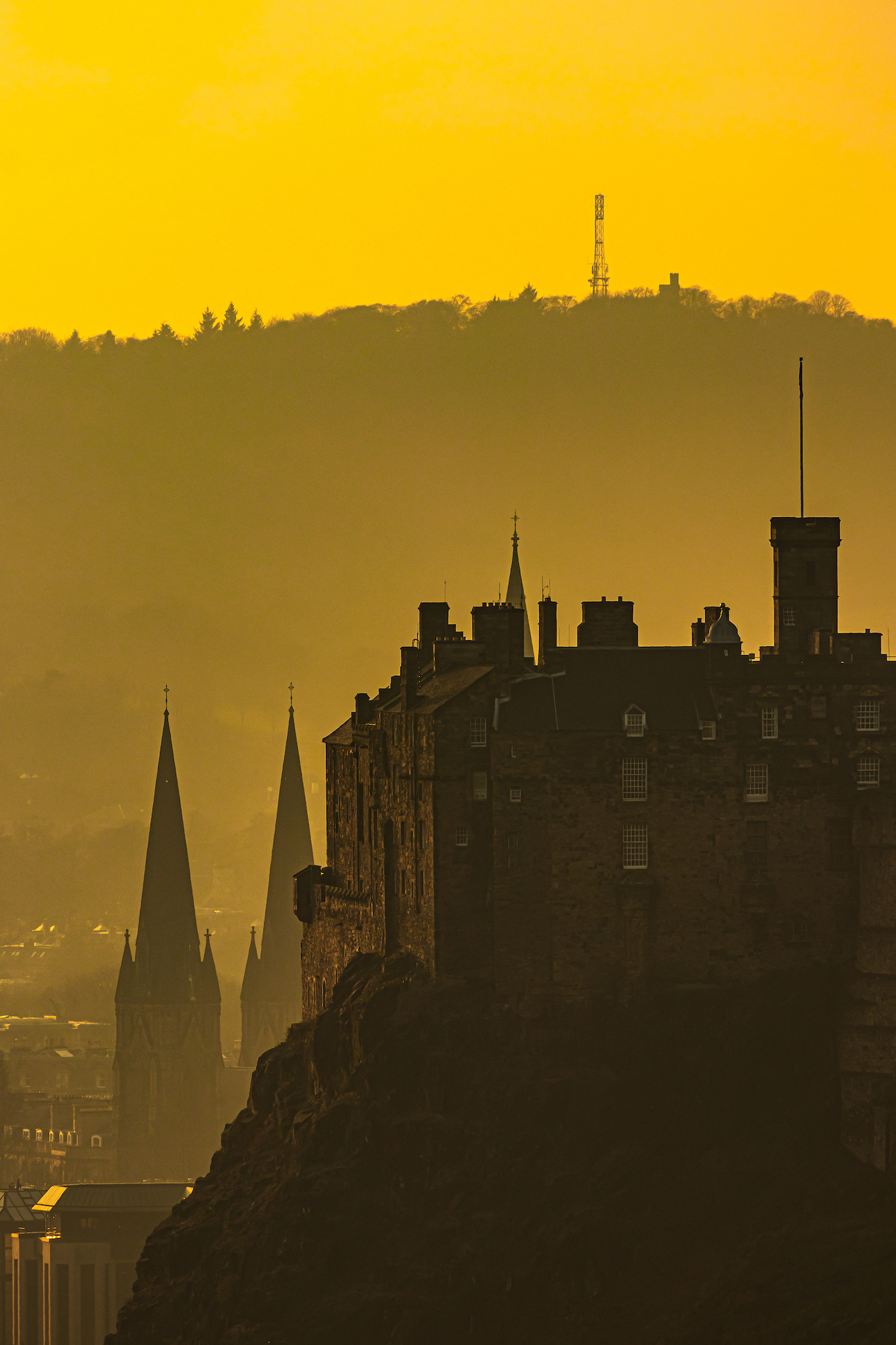 (1378) Moody Golden Sunset Over Edinburgh Castle and St Mary's Episcopal Cathedral, Corstorphine Hill in Background, Edinburgh, Scotland. 27 February 2019. Copyright David Wheater.jpg
