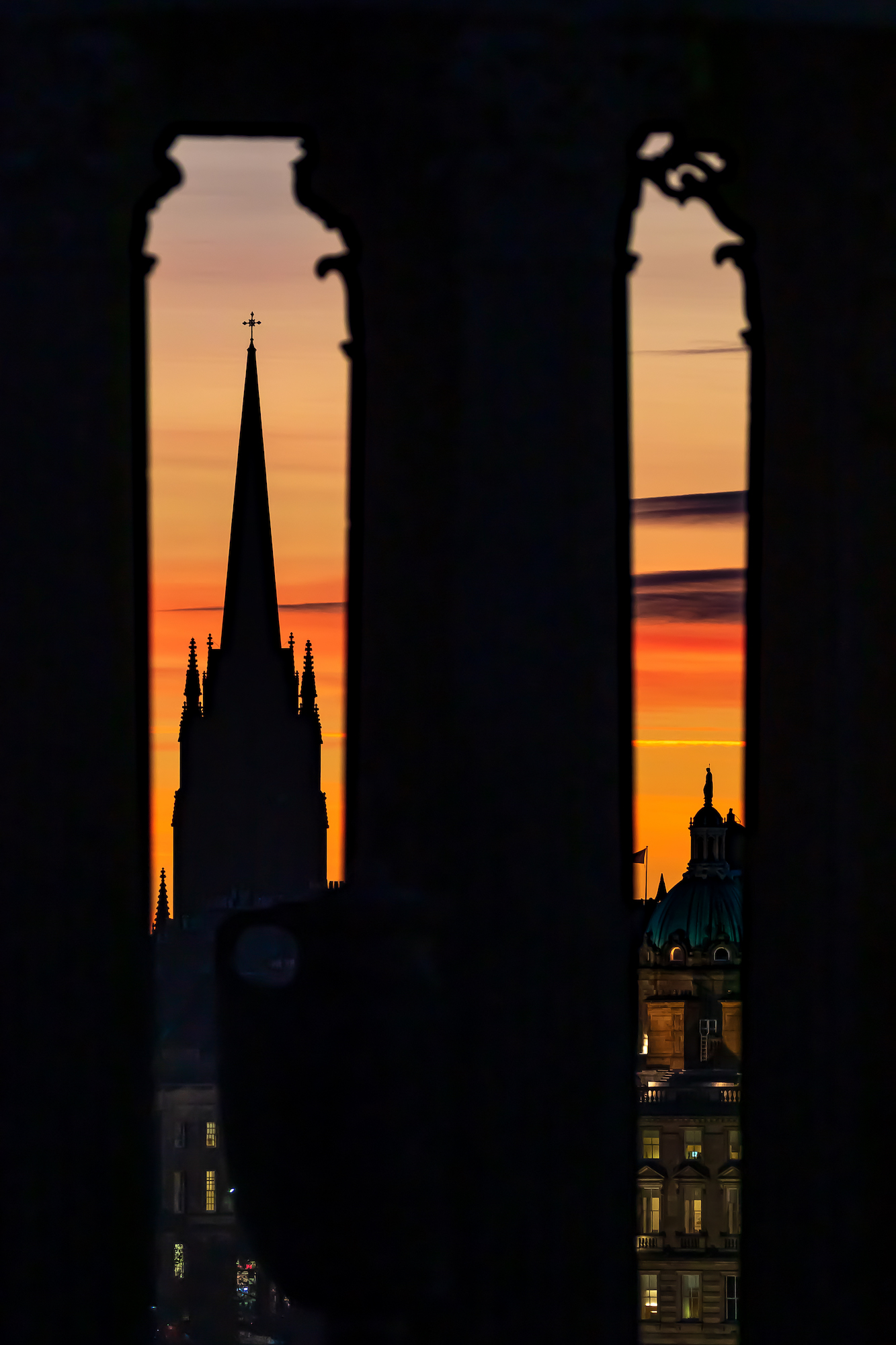 (1386) The Gothic Spire of The Hub Arts & Events Centre and Statue on top of Lloyds Banking Group Head Office through the Dugald Stewart Monument on Calton Hill, Edinburgh, Scotland. Copyright David Wheater.jpg