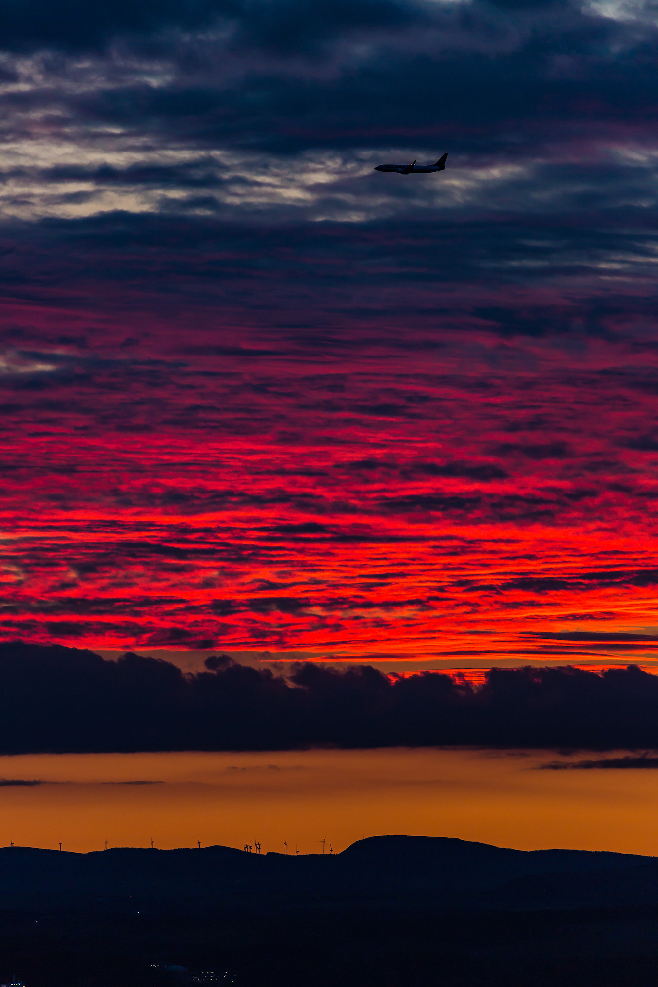 (608) Fiery Red Sunset over Fife, as Plane lands over Firth of Forth for Edinburgh Airport, Edinburgh, Scotland. Copyright David Wheater.jpg