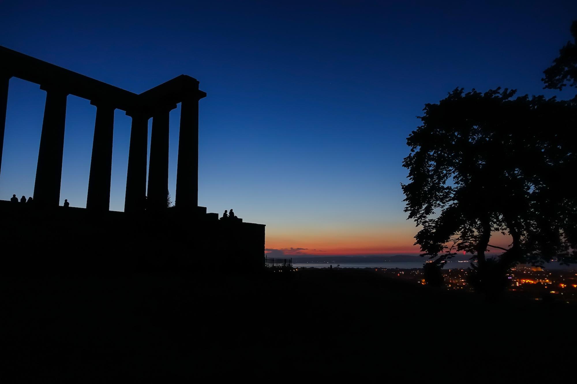 (238) Watching the sun go down over Edinburgh, The National Monument of Scotland, Calton Hill, Edinburgh, Scotland.jpg