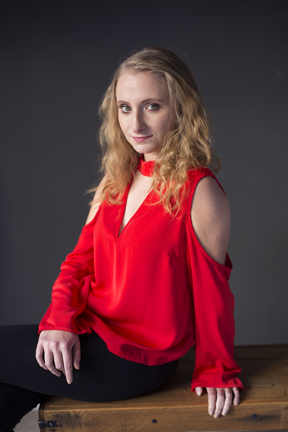 Charlotte's red top looks so striking against the dark background! -