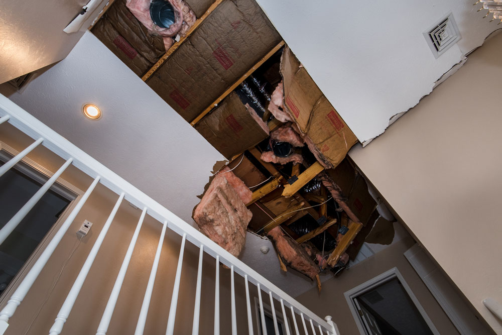 Before photo - damage to foyer ceiling.