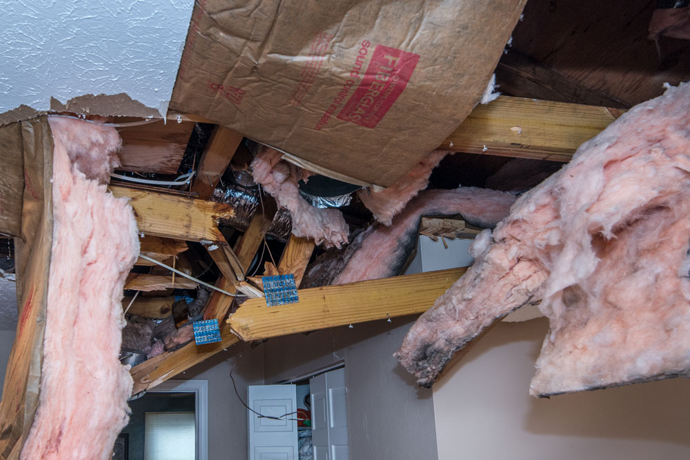 Before photo - damage to interior wall/ceiling cavities.