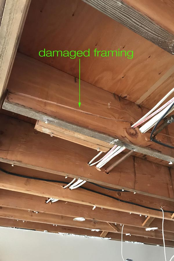 Before photo - cracked framing above ceiling.