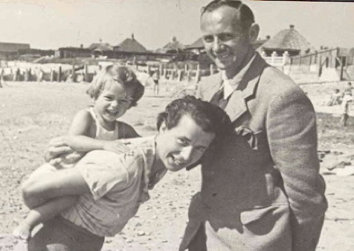 Mum, Dad and 15 month old Ann on the beach at Middleton, 1939.