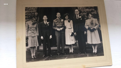 Doris and John in the middle on their wedding day