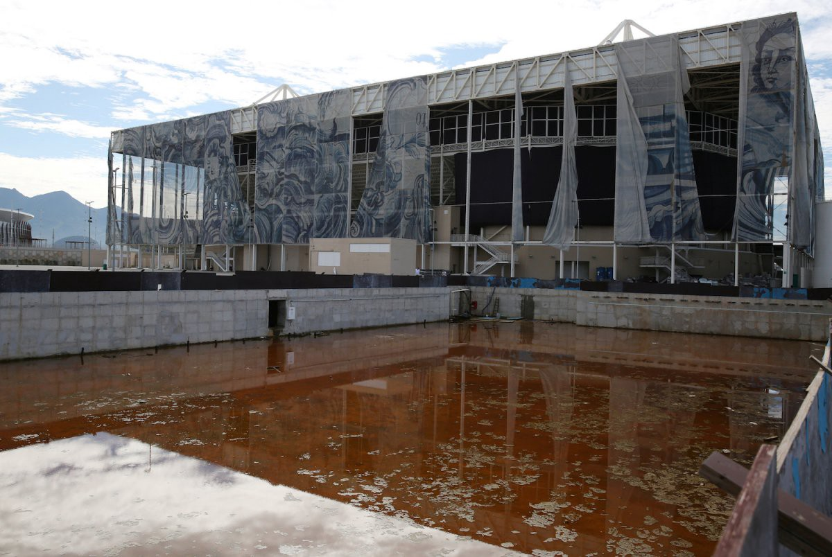 One practice pool has turned orange, and the structure next to it is quite literally falling apart | Pilar Olivares/Reuters