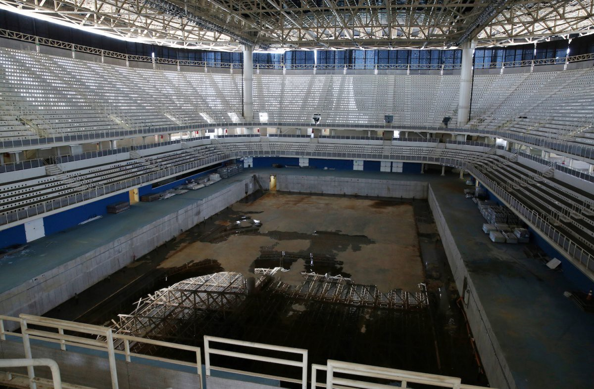 Inside the Aquatic Center, the pool is drained except for some unpleasant standing water | Pilar Olivares/Reuters