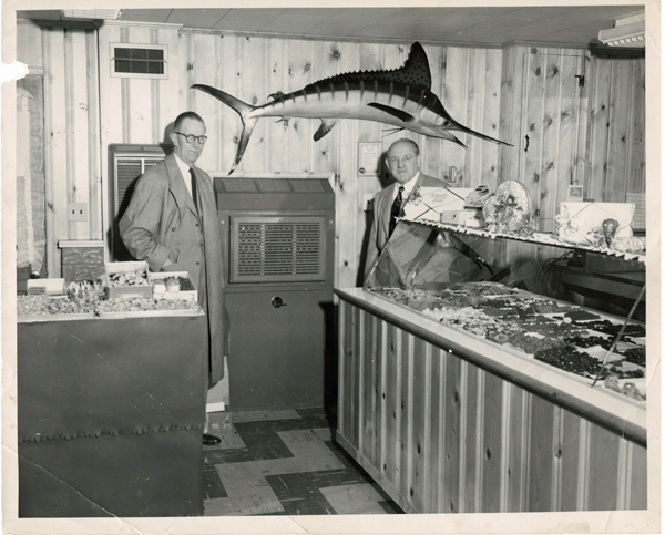 Louis Rheb (l) with an unidentified man inside the Rheb's circa 1950s retail space.