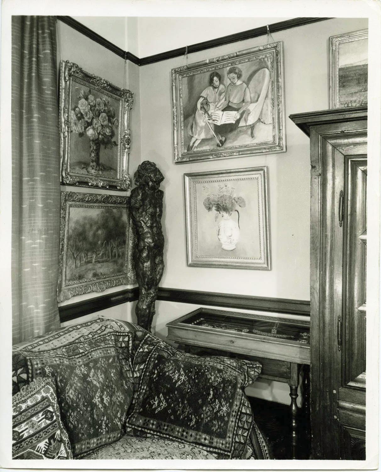 Claribel's apartment included tapestries, sculptures, drawers full of treasures, as well as Henri Matisse's     The Music Lesson: Two Women Seated on a Diva n    (1921) on the upper right.  Historic photos on this page used with permission of the Baltimore Museum of Art Claribel Cone's apartment (8B), Marlborough Apartments, Baltimore, Maryland, Circa 1926-1949. Claribel and Etta Cone Papers, Archives and Manuscripts Collections, The Baltimore Museum of Art. CECHOMES.15
