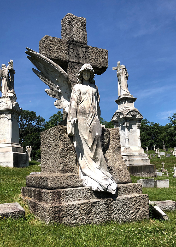 The John Cook family gravesite is located in Section V-119 in New Cathedral Cemetery. The angel's broken left wing lies on the ground next to the statue.