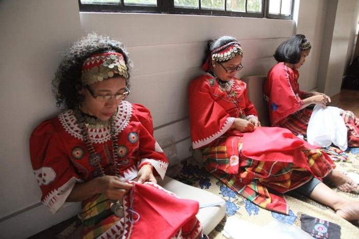 Rowena Rafil, Julie Casipe, and Regina Villanueva demonstrate Panay Bukidnon embroidery during a two-day weaving demonstration on October 18-19, 2014 at the Hibla ng Lahing Filipino at the Museum of the Filipino People in Manila.
